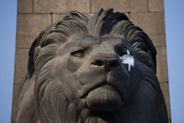 The sculpture of a lion on the Qasr el-Nil bridge wears an eye patch symbolizing protesters wounded in clashes with security forces, near Tahrir Square in Cairo, Egypt, Saturday, Nov. 26, 2011. Egyptian medical officials say that one demonstrator has been killed outside the country's Cabinet building, where protesters have camped overnight to prevent the entrance of the country's newly-appointed prime minister.(AP Photo/Bernat Armangue)