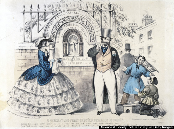UNITED KINGDOM - AUGUST 16: Tinted lithograph by C J Culliford, showing a man and woman beside a wall-mounted fountain offering 'filtered New River' water. A butcher's boy and a shoeblack make humorous comments. The butcher?s boy says that the woman in the crinoline has been careful to wipe out the cup before drinking. The shoeblack replies that it?s because the top-hatted man?s beard has just been in the cup. The fountain's inscription reads 'The Gift of Samuel Gurney MP, 1859' made by the Metropolitan Drinking Fountain Association. Water suitable for drinking was brought from Befordshire to London via the 'New River' (completed 1613), a canal built under the direction of Sir Hugh Middleton (1560-1631). (Photo by SSPL/Getty Images)